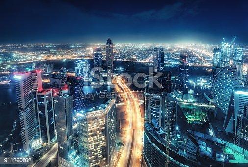 istock Scenic nighttime skyline of big cmodern city with illuminated skyscrapers. Dubai, UAE. 911260862