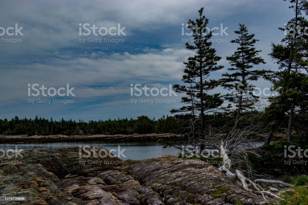 Scenic ocean view of the rocky rugged coastline of Middle Island looking to Outer Island in Lunenburg county, Nova Scotia. stock photo