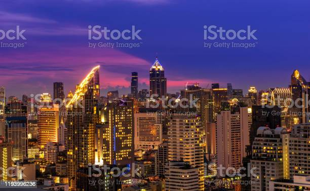 Scenic of night urban cityscape skyline and golden building with picture id1193996236?b=1&k=6&m=1193996236&s=612x612&h=z4cz66hon7f9 o8fvaakkqtf0wddwgl6r0d nlfxsyu=