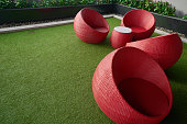 scenic of relax zone with red wheats seat on grass floor