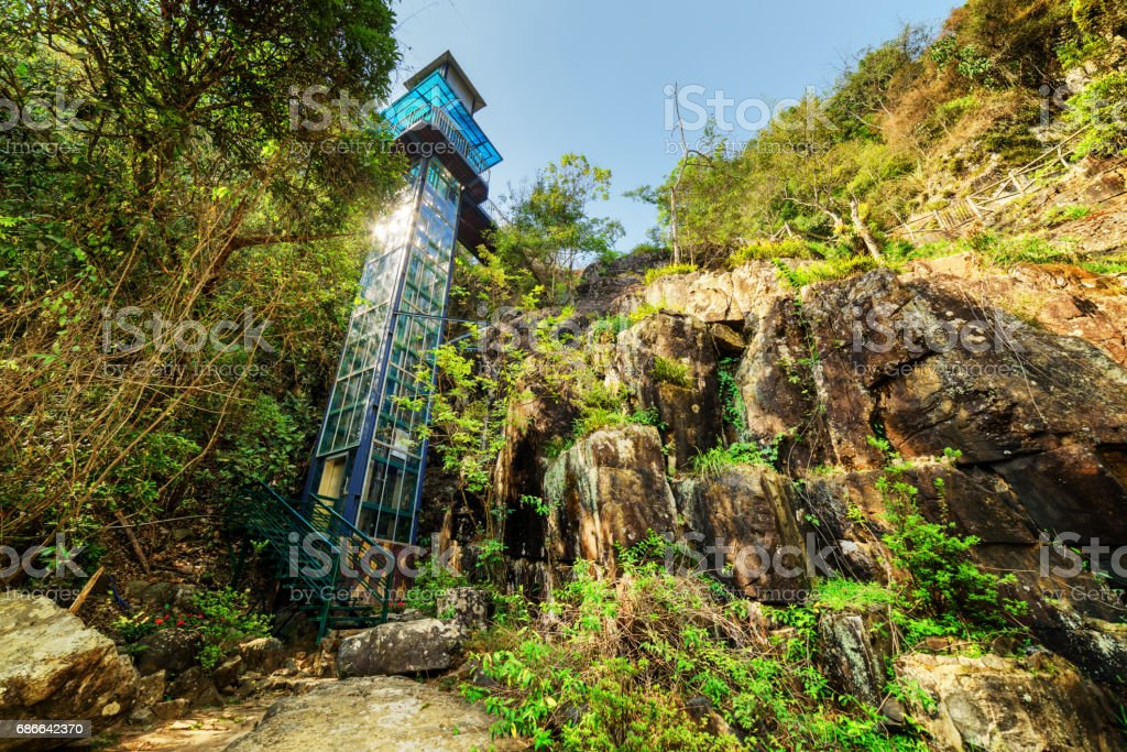 Scenic outdoor elevator in forest. Datanla waterfall park, Da Lat, Vietnam stock photo
