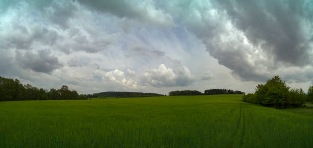 scenic panorama view of natural landscape under a cloudy sky stock photo