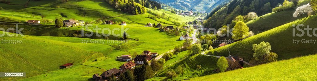 Scenic panoramic landscape of a picturesque mountain valley in spring. Germany, Black Forest. stock photo