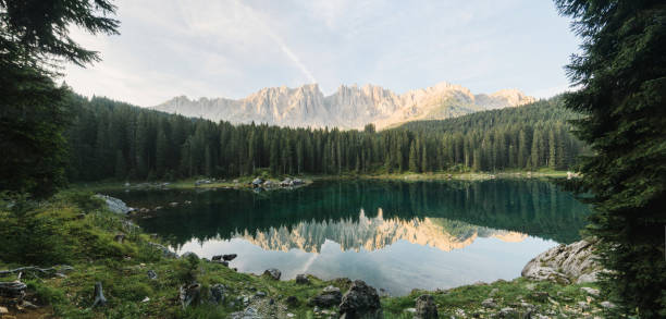 scenic panoramic view of lago di carezza in dolomites - latemar foto e immagini stock