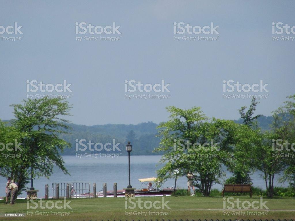 Scenic park along tranquil shore of Tupper Lake, NY stock photo