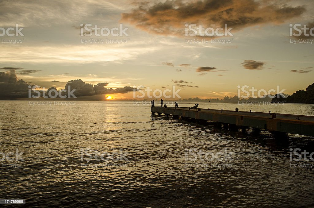 scenic pier and silhouette of children royalty-free stock photo