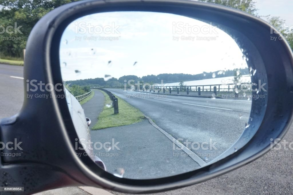 Scenic Reflection in Car Wing Mirror stock photo