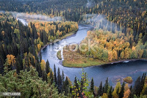 istock Scenic river landscape with fall colors woodland at autumn morning in National Park, Finland 1062149958