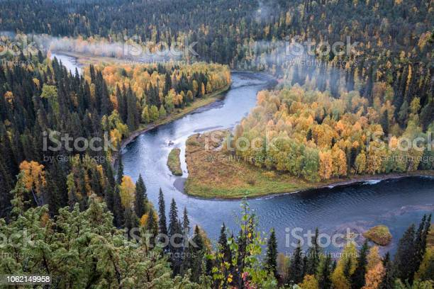 Photo of Scenic river landscape with fall colors woodland at autumn morning in National Park, Finland