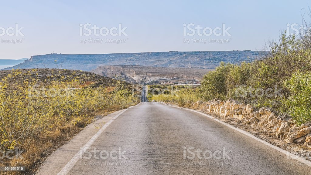 Scenic road with views of the mountains at sunset stock photo