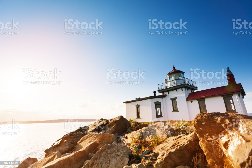 Scenic rock formations with West Point Lighthouse stock photo