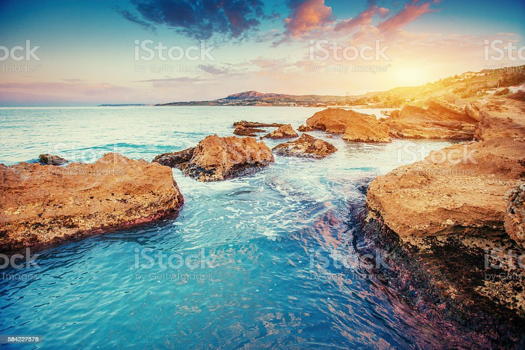 Scenic rocky coastline Cape Milazzo.Sicily, Italy. stock photo