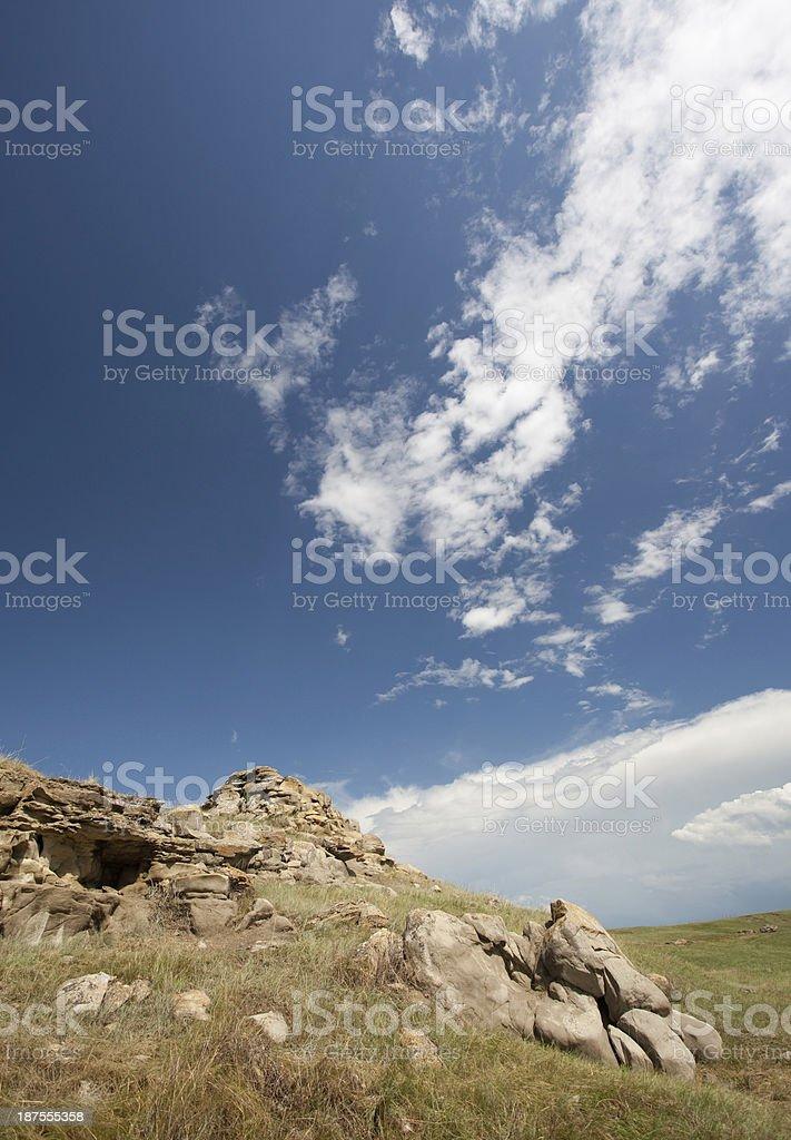 Scenic rocky terrain under beautiful blue cloudy sky. stock photo