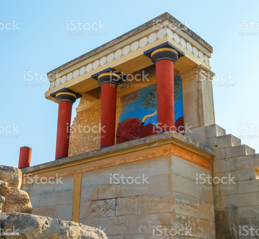 Scenic ruins of Minoan Palace of Knossos.North entrance with bull fresco. Heraklion.Crete island. Greece.Europe stock photo