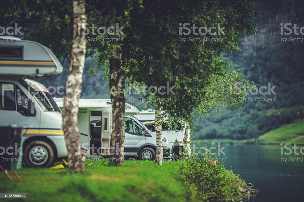 RV Park Camping at Night - Photo - Welcomia Imagery Stock