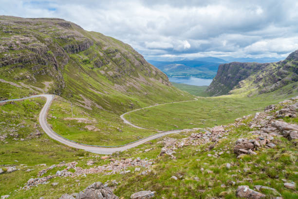 Scenic sight near Bealach na Ba viewpoint, in Applecross peninsula in Wester Ross, Scottish Higlands. Scenic sight near Bealach na Ba viewpoint, in Applecross peninsula in Wester Ross, Scottish Higlands. north coast 500 stock pictures, royalty-free photos & images