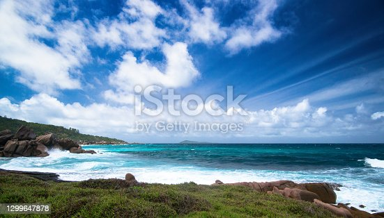 Blue sea and exclusive remote beach in Seychelles islands (La Digue)
