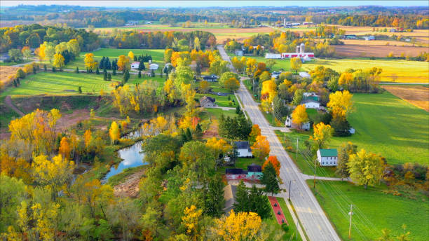 Scenic Small Town Nestled Amid Fertile Valley In Beautiful Rural Wisconsin Scenic Small Town Nestled in Autumn Valley, Beautiful Rural Wisconsin Fall colors. wisconsin stock pictures, royalty-free photos & images