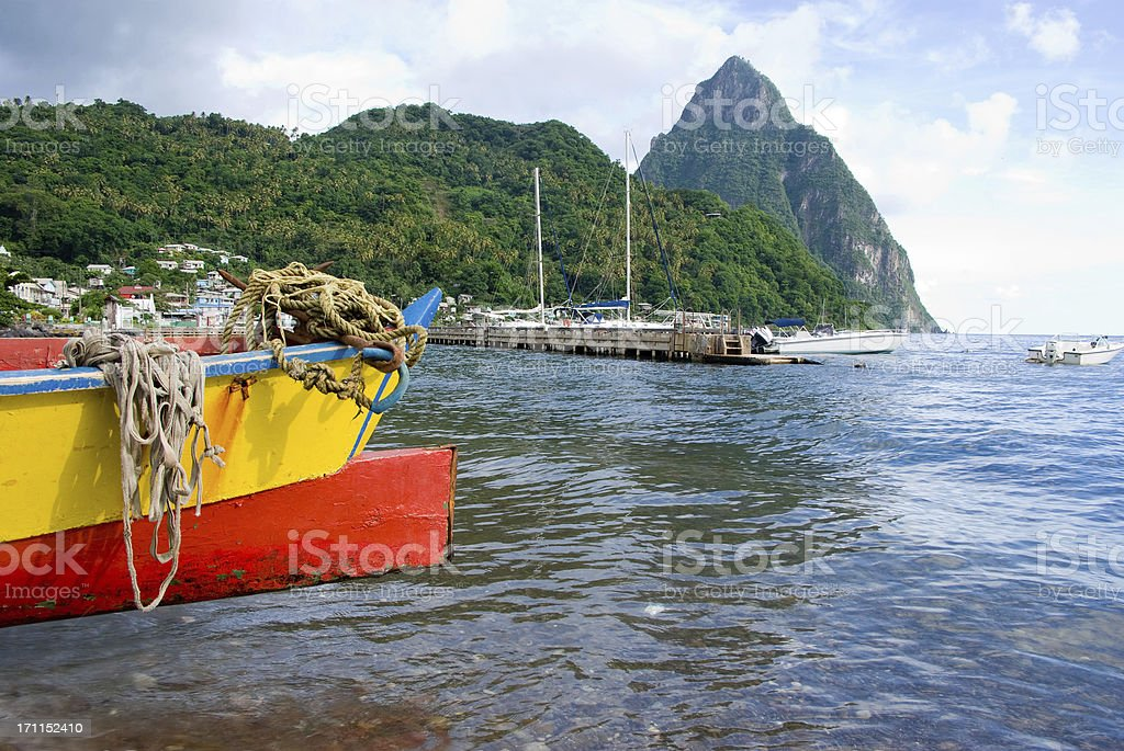 scenic soufriere with pitons and fishing boat stock photo