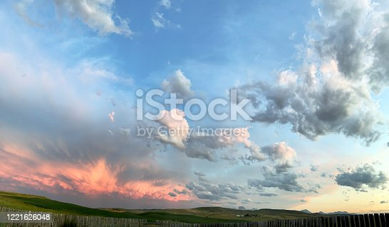 Scenic southern Alberta prairie sunset , with distant view of Chief Mountain near Cardston.