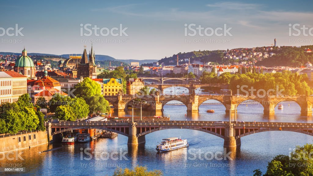 Scenic spring sunset aerial view of the Old Town pier architecture and Charles Bridge over Vltava river in Prague, Czech Republic stock photo