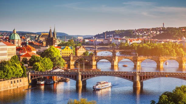 scenic spring sunset aerial view of the old town pier architecture and charles bridge over vltava river in prague, czech republic - чехия стоковые фото и изображения