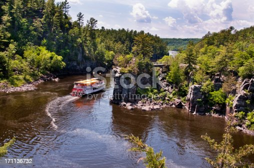 A Paddle Boat travels down the scenic St. Croix River. The St. Croix River borders Minnesota and Wisconsin.