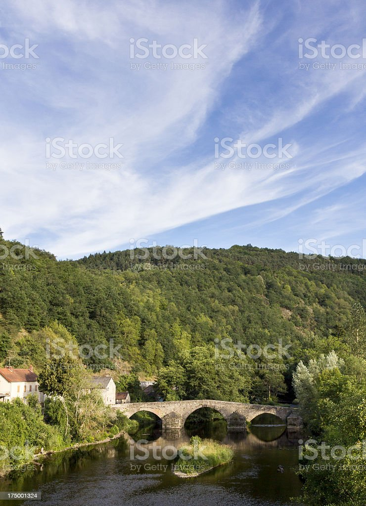 Scenic stone river bridge in Auvergne countryside, France stock photo