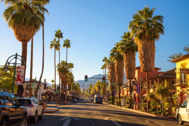 Scenic street view of Palm Springs at sunrise Palm Springs, California, USA - December 27, 2017 : Scenic street view of Palm Springs at sunrise. It is a desert resort city in Riverside County within the Coachella Valley. riverbank stock pictures, royalty-free photos & images