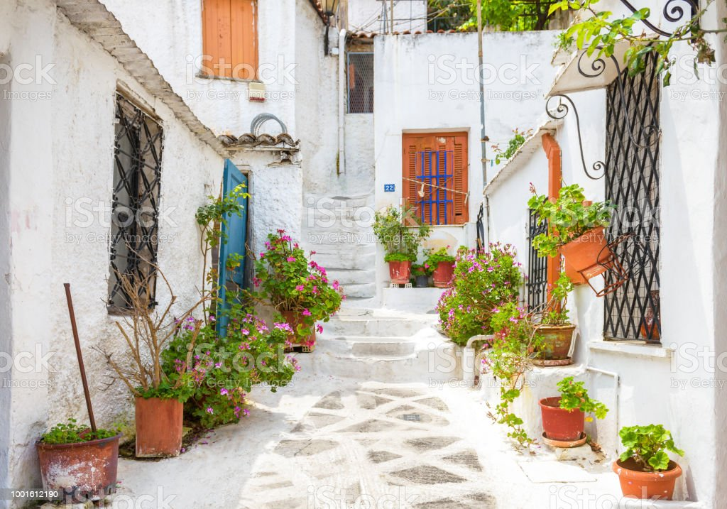 Scenic street with old houses in Anafiotika in Plaka district, Athens, Greece stock photo