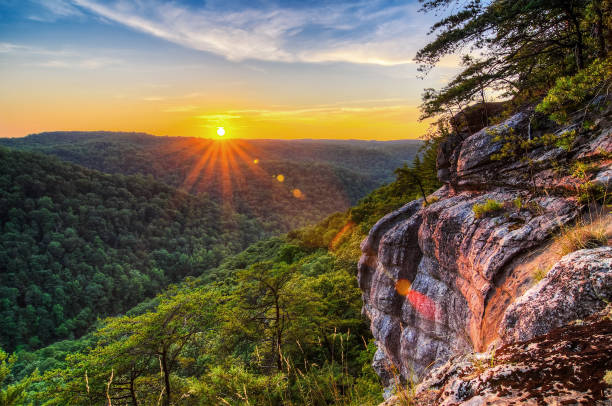Scenic summer sunset along cliffline A scenic summer sunset along one of the many rocky outcroppings in the Big South Fork National River and Recreation Area in Tennessee. tennessee stock pictures, royalty-free photos & images