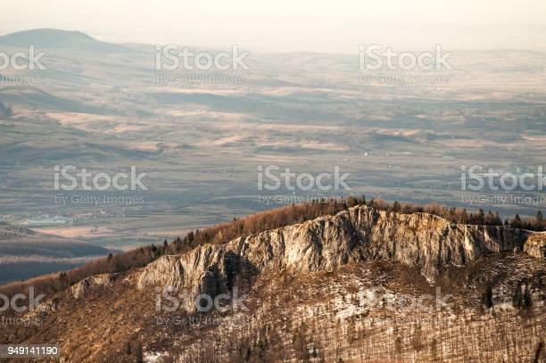 Photo of Scenic sunlit cliff