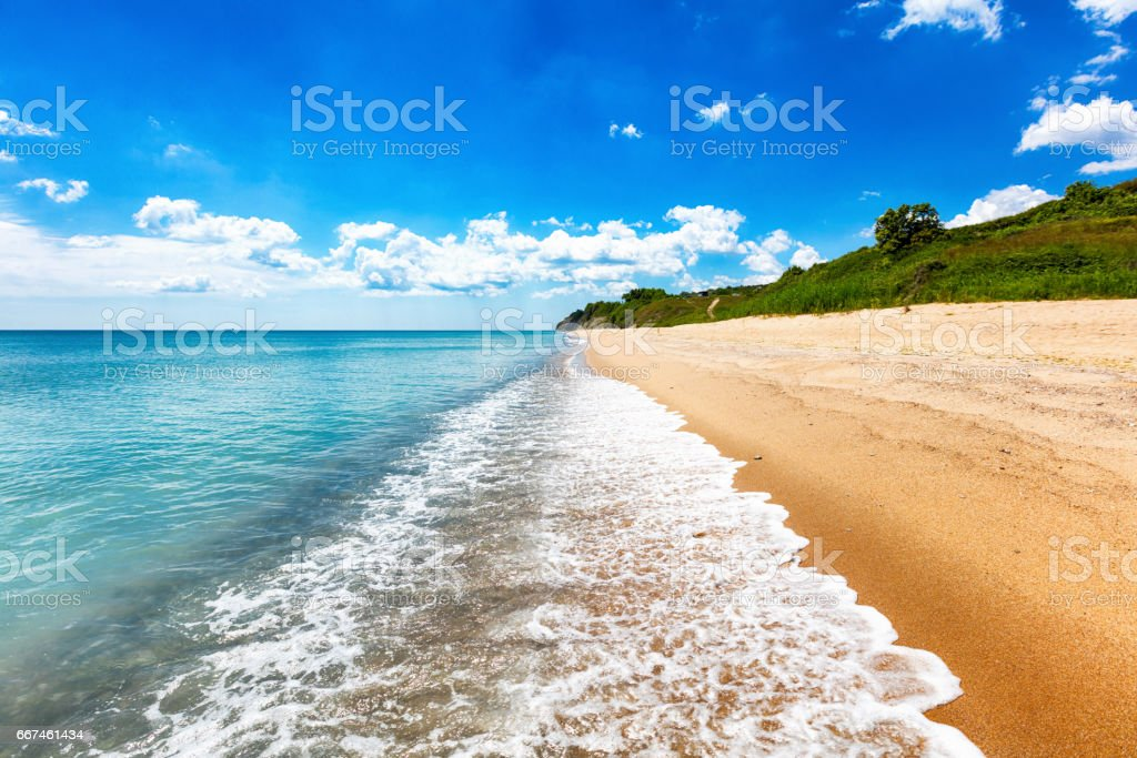 Scenic sunny beach with azure sea stock photo