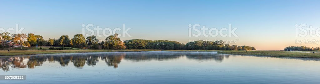 scenic sunrise at the canals in Essex stock photo