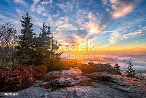 istock Scenic sunrise over fog filled valley 846819498