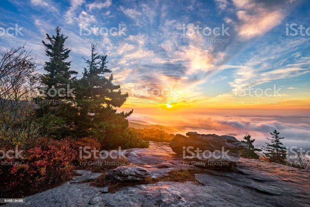 Scenic sunrise over fog filled valley stock photo