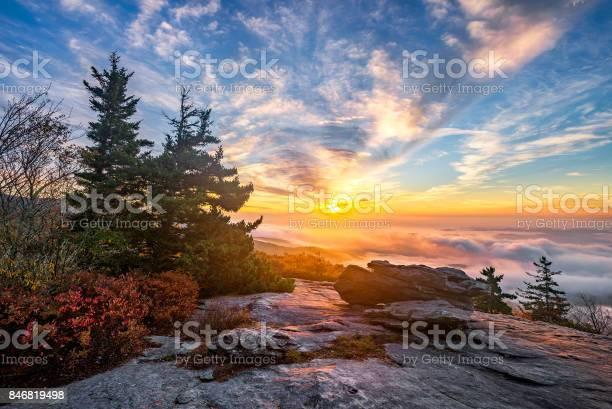 Photo of Scenic sunrise over fog filled valley
