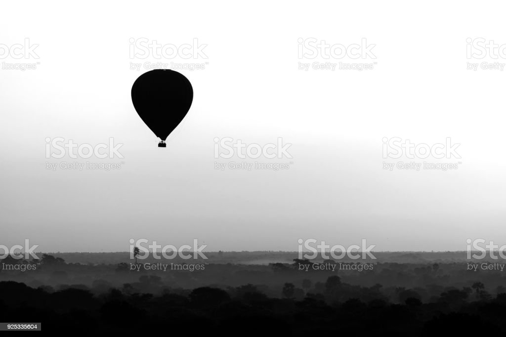 Scenic sunrise with a hot air balloon above Bagan in Myanmar. stock photo