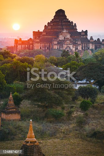 Scenic sunrise with many hot air balloons above Bagan Dhammayangyi temple in Myanmar. Bagan is an ancient city with thousands of historic buddhist temples and stupas.