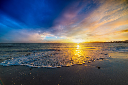 Scenic sunset in Maria Pia beach shore. Alghero, Italy