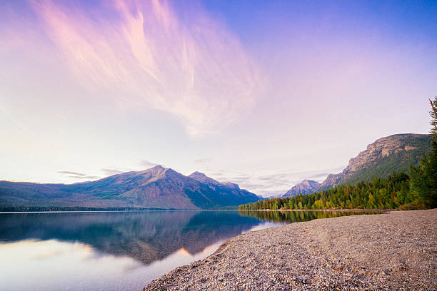 scenic sunset lake mcdonald reflections glacier national park montana - mcdonald lake stock pictures, royalty-free photos & images