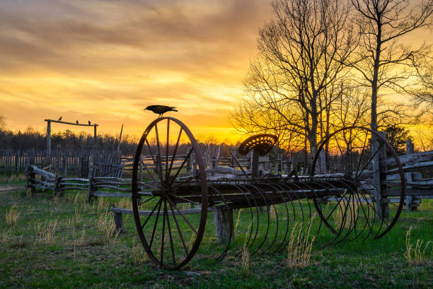 Scenic sunset over old farmstead stock photo