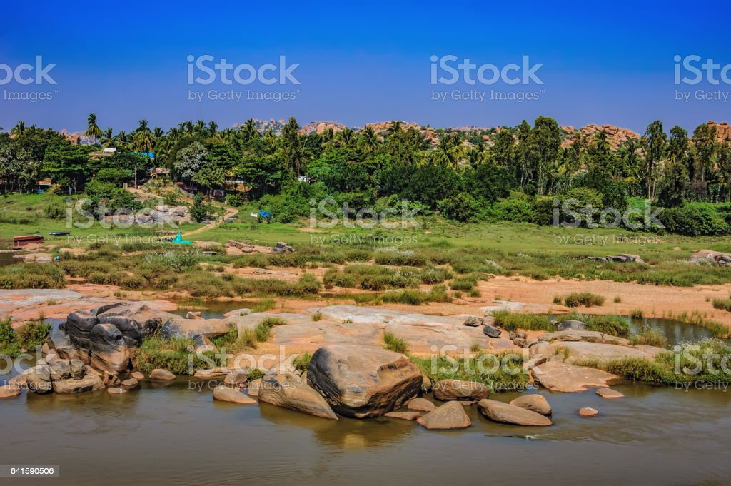 Scenic Tungabhadra River bank in Hampi, India stock photo