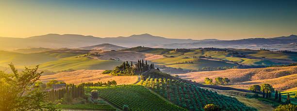 Scenic Tuscany landscape panorama at sunrise, Val d'Orcia, Italy stock photo