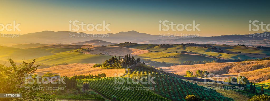 Scenic Tuscany landscape panorama at sunrise, Val d'Orcia, Italy stock photo