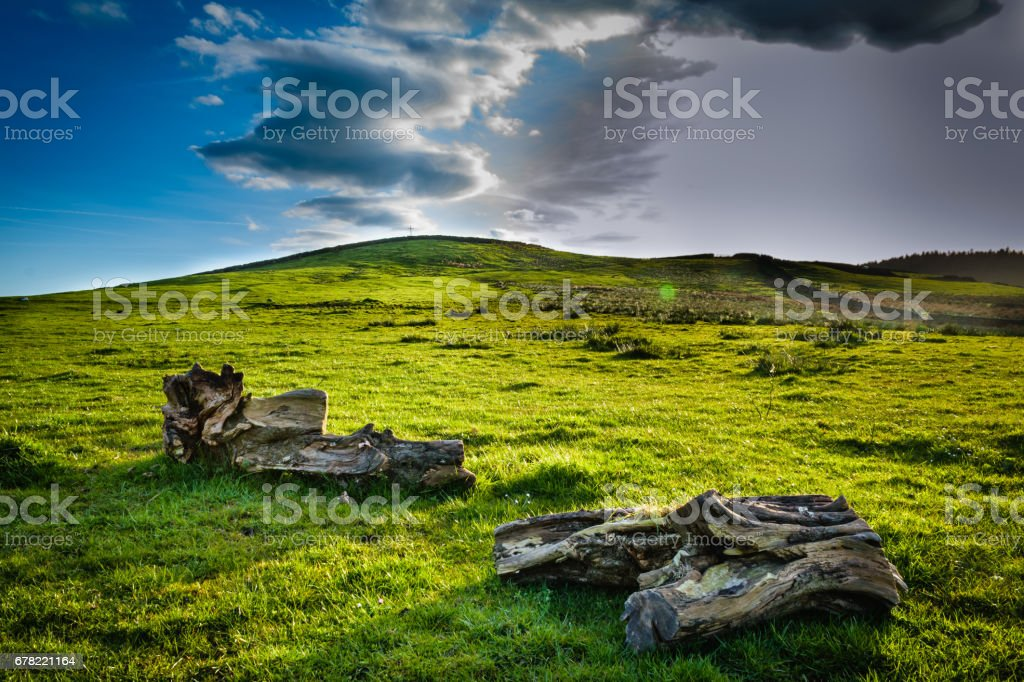 Scenic Uphill View At Mountain Top with Holy Cross and Old Tree Branches stock photo