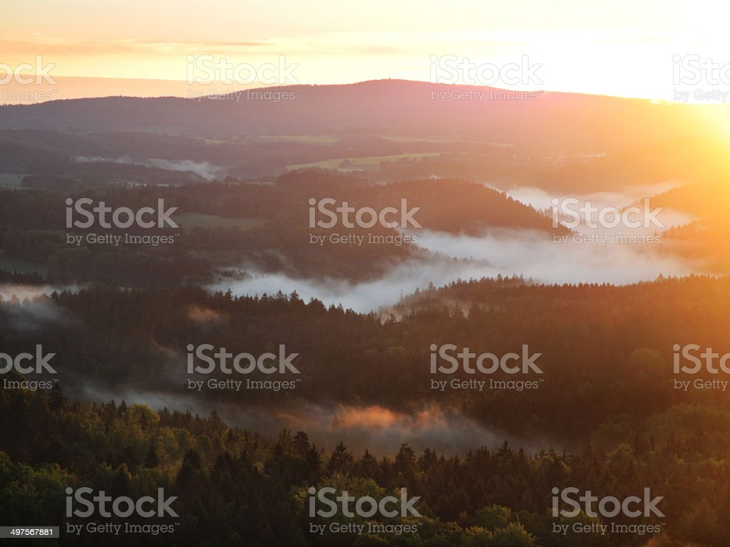 Scenic view at hills and misty forests in morning light stock photo