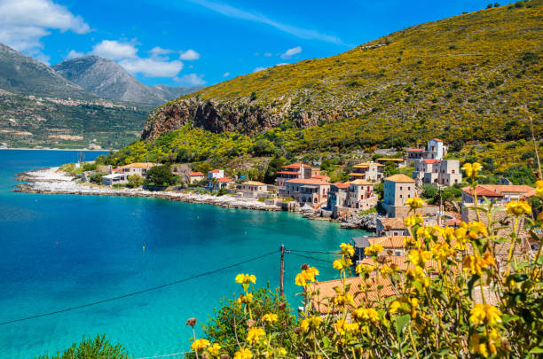 Scenic view at the picturesque village of limeni with the beautiful alleys,turquoise waters and the characteristic stone tower buildings. stock photo