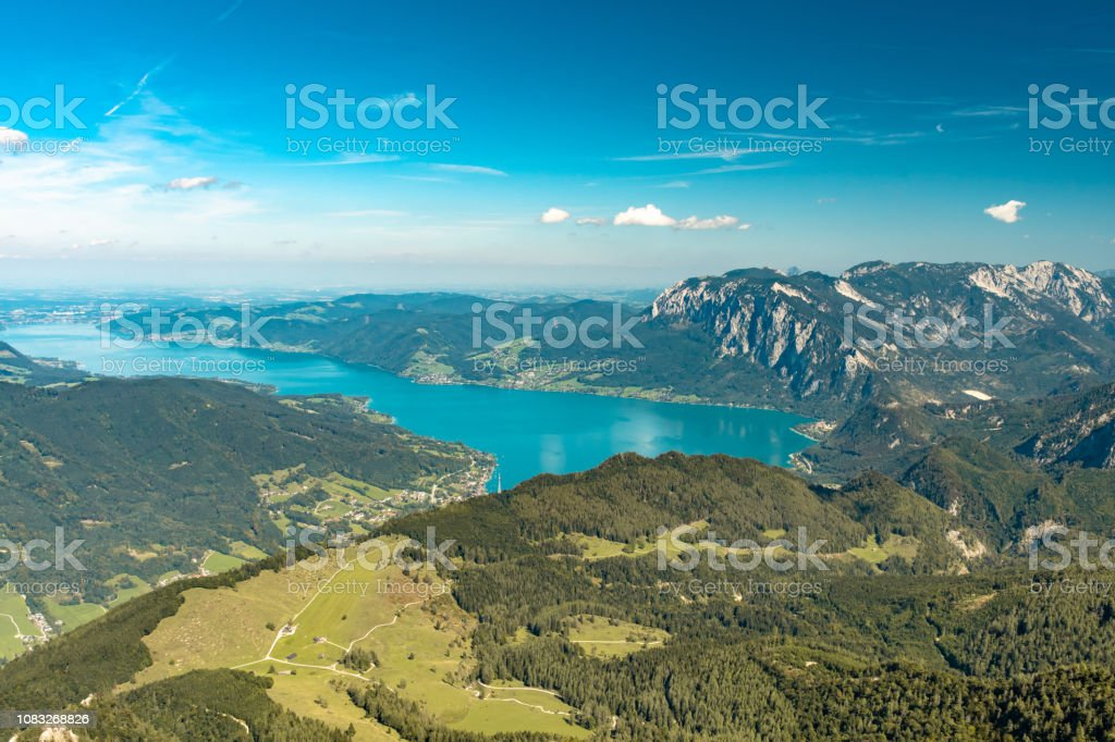 Scenic view from Schafberg over the alpine foothills of Northern Limestone Alps and Attersee Lake. stock photo
