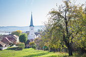 Beautiful landscape image of a typical small town in Transylvania, Romania in autumn.